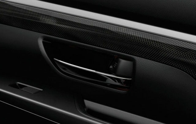 carbon-fibre-patterned-material-and-satin-chrome-accents-min